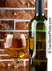 Wine bottle and wall - Glass and bottle wine on wooden table