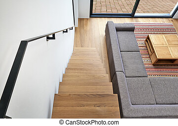 Hardwood stairs and ramp in modern living room - Hardwood...
