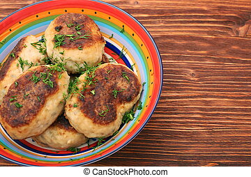 Fried savory fish patties with green