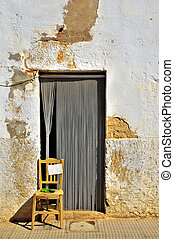 mediterranean village - a view of a front door in a little...