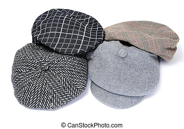 flat caps and bonnets - some flat caps and bonnets isolated...