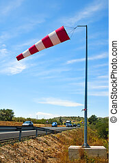 windsock - a windsock inflated by the wind on a road