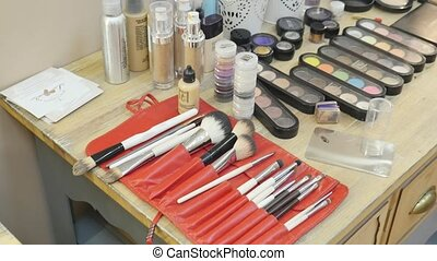 Set of brushes make up application tools laying on a table randomly