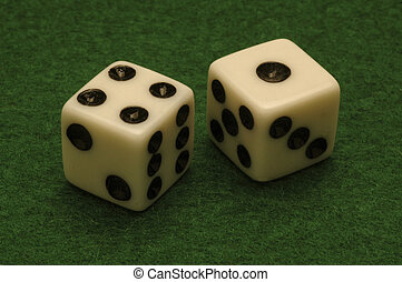 Dice on a green felt gambling table