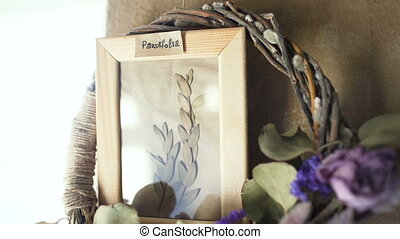 Parvifolia leaves in picture frame on wall interior