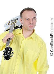 Young man with a black guitar Isolated on white background