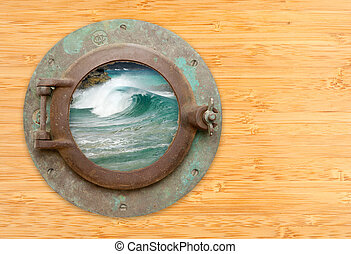 Antique Porthole with View of Crashing Waves on a Bamboo Wall Background.