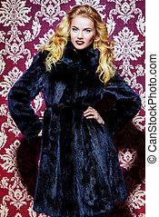 mink fur coat - Beautiful blonde woman wearing mink fur...