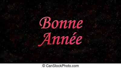 "Happy New Year text in French ""Bonne annee"" formed from dust and turns to dust horizontally on black animated background"