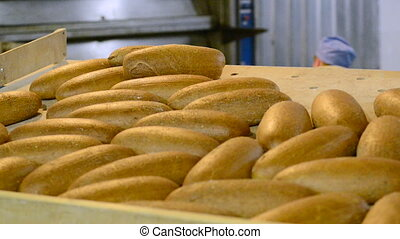 traditional bakery bakes bread from wheat flour and dough...