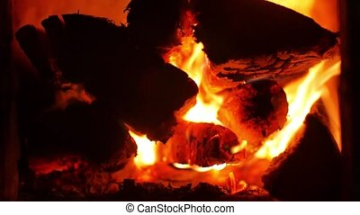 Hot fireplace full of wood and fire. Fire burning in slow...