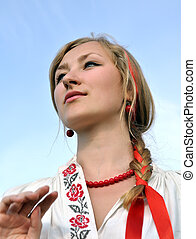 close-up portrait of young ukrainian woman in traditional...