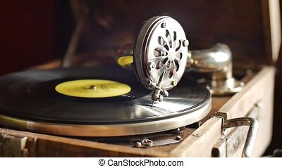 Loop-able Vintage Video of Old Gramophone, playing a record,...