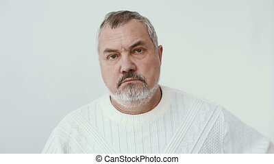 Middle aged bearded man looks to camera