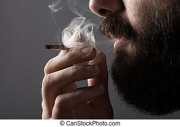 Smoking Man - Detail of a Man with a Beard Smoking a...