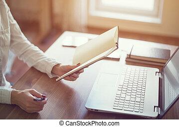 Woman freelancer working at home telework taking notes. -...