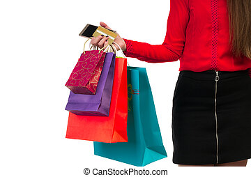 Woman hand holding colourful shopping paper bags, packages, credit card