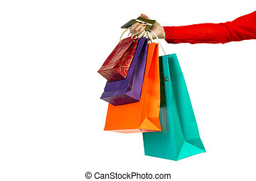 Woman hand holding colourful shopping paper bags, banking credit card