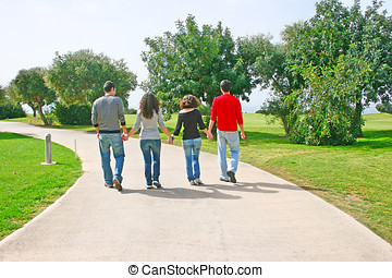 Teens walking on countryside path