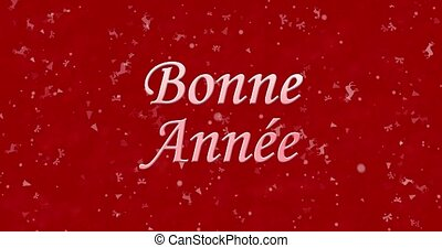 "Happy New Year text in French ""Bonne annee"" formed from dust and turns to dust horizontally on red animated background"