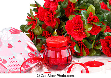 Valentine's day - Red flowers, candles and gift box close up...