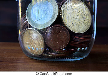 money - coins in the glass bottle
