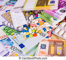 Health insurance concept with pills and money. Medicine cost...