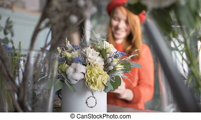 Florist girl making a flower composition