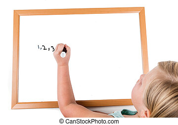 Young girl drawing on a dry erase board with a marker