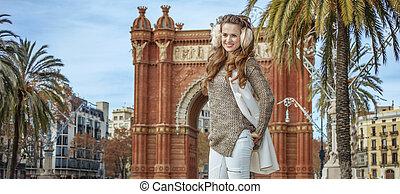 happy young woman in earmuffs in Barcelona, Spain - in...