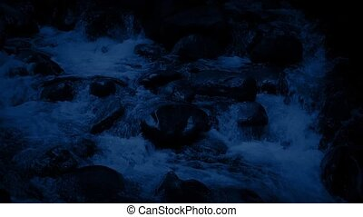 Rocky Mountain River At Night - Closeup of rocky river...