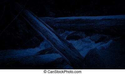 Snowy Logs Over River At Night - Large logs in the snow...