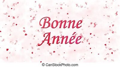 "Happy New Year text in French ""Bonne annee"" formed from dust and turns to dust horizontally on white animated background"
