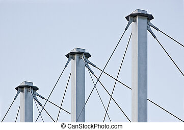 Tied Suspension Roof Cables, Three Tall Grey Masts,...
