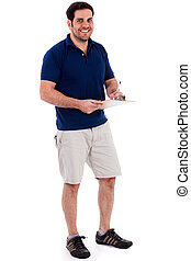 Full length image of a handsome young guy standing isolated...