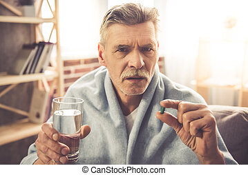 Mature man having a cold