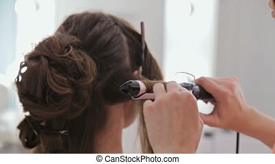 4 shots. Professional hairdresser doing hairstyle for young...