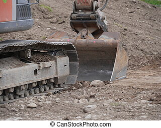 dredge - Excavator bucket dredging sand and gravel