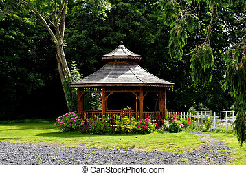 wooden pergola - picturesque view of a wooden pergola