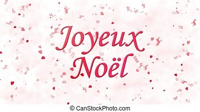 """Merry Christmas text in French """"Joyeux Noel"""" turns to dust from bottom on white animated background"""