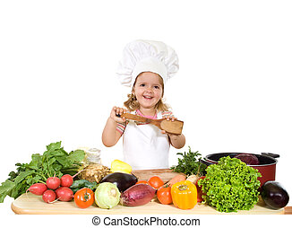 Happy little chef with lots of vegetables