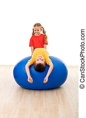 Kids having fun with large exercise ball