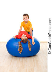 Kids having fun with a large exercise ball