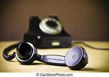 Telephone - Vintage Rotary Dial Telephone. Soft focus with...