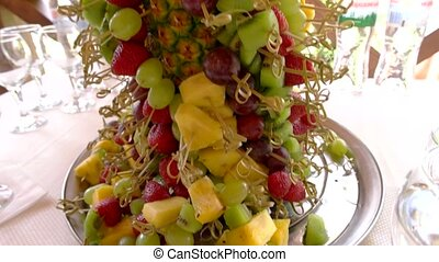 Fruit tower on tray. Grapes and sliced pineapple. Fresh...