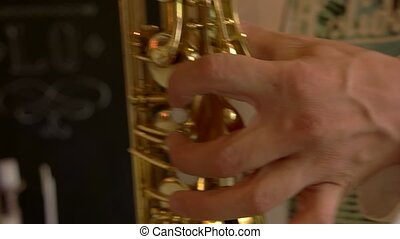 Male hand and saxophone. Man playing sax. Jazz as an art.