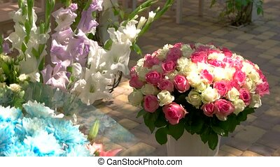 Bouquets of different flowers. Chrysanthemums and roses....