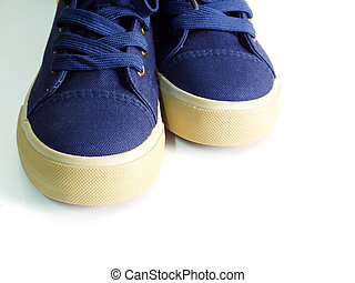blue sneakers on white background with copy space top view