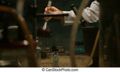 Strange scientist prepares a potion in the underground...