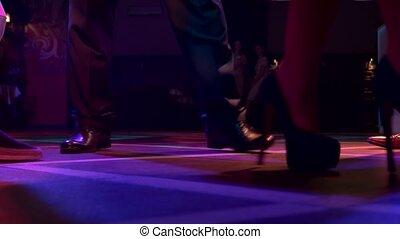 Legs of people dancing.
